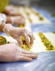 Gourmet food being manufactured by hand.